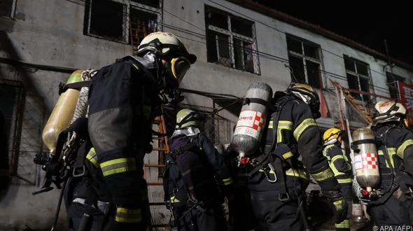 Peking: 19 Tote bei Brand -