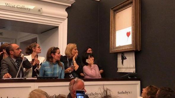 Banksy-Kunstwerk schreddert sich nach Auktion selbst